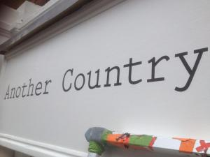 Another Country Sign by NGS