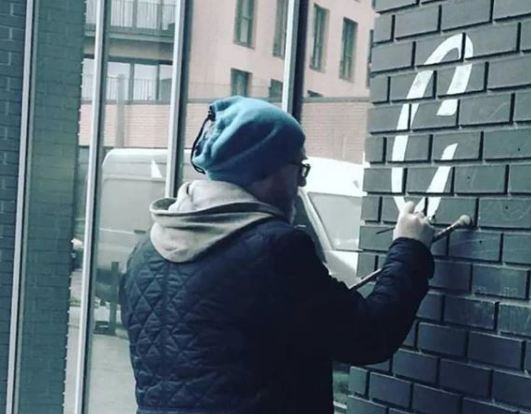 ngs nick garrett signwriting on the wall in wapping london